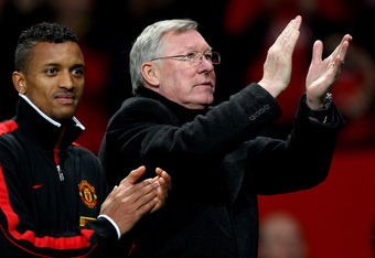 MANCHESTER, ENGLAND - DECEMBER 26:  Manchester United Manager Sir Alex Ferguson applauds the fans as he walks off with Nani at the end of the Barclays Premier League match between Manchester United and Wigan Athletic at Old Trafford on December 26, 2011 i