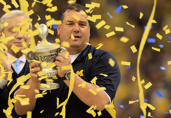 NEW ORLEANS, LA - JANUARY 03:  Head coach Brady Hoke of the Michigan Wolverines celebrates with the trophy after Michigan won 23-20 in overtime against the Virginia Tech Hokies during the Allstate Sugar Bowl at Mercedes-Benz Superdome on January 3, 2012 i