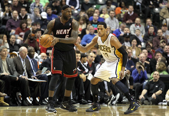 INDIANAPOLIS - FEBRUARY 15: LeBron James #6 of the Miami Heat is guarded by Danny Granger #33 of the Indiana Pacers during the NBA game at Conseco Fieldhouse on February 15, 2011 in Indianapolis, Indiana.   The Heat won 110-103.   NOTE TO USER: User expre