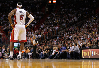 MIAMI, FL - DECEMBER 27:  LeBron James #6 of the Miami Heat stands on the court during a game against the Boston Celtics at American Airlines Arena on December 27, 2011 in Miami, Florida. NOTE TO USER: User expressly acknowledges and agrees that, by downl