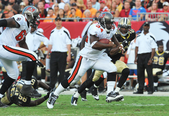 TAMPA, FL - OCTOBER 16: Running back Earnest Graham #34 of the Tampa Bay Buccaneers rushes upfield during play against the New Orleans Saints October 16, 2011 at Raymond James Stadium in Tampa, Florida. (Photo by Al Messerschmidt/Getty Images)