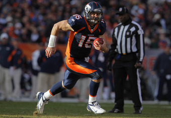 DENVER, CO - JANUARY 01:  Quarterback Tim Tebow #15 of the Denver Broncos rushes witht the ball against the Kansas City Chiefs at Sports Authority Field at Mile High on January 1, 2012 in Denver, Colorado. The Chiefs defeated the Broncos 7-3 as the Bronco