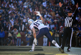 LANDOVER, MD - DECEMBER 11:  Rob Gronkowski #87 of the New England Patriots celebrates after scoring a touchdown against the Washington Redskins at FedExField on December 11, 2011 in Landover, Maryland.  (Photo by Patrick McDermott/Getty Images)