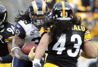 PITTSBURGH, PA - DECEMBER 24:  Steven Jackson #39 of the St. Louis Rams carries the ball against Troy Polamalu #43 of the Pittsburgh Steelers during the game on December 24, 2011 at Heinz Field in Pittsburgh, Pennsylvania.  (Photo by Justin K. Aller/Getty
