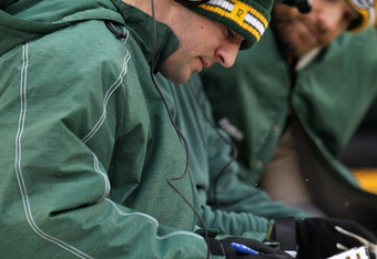 Rodgers going over the playbook with Matt Flynn