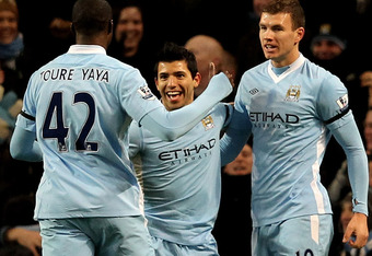MANCHESTER, ENGLAND - JANUARY 03:  Sergio Aguero of Manchester City celebrates with his team mates Yaya Toure and Edin Dzeko (R) after scoring the opening goal during the Barclays Premier League match between Manchester City and Liverpool at the Etihad St