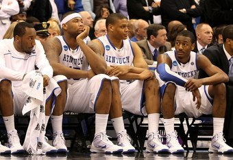 SYRACUSE, NY - MARCH 27:  (L-R) Ramon Harris #5, DeMarcus Cousins #15, Daniel Orton #33 and John Wall #11 of the Kentucky Wildcats look on dejected from the bench in the final minute of the second half against the West Virginia Mountaineers during the eas