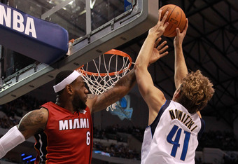 DALLAS, TX - DECEMBER 25:  LeBron James #6 of the Miami Heat fouls Dirk Nowitzki #41 of the Dallas Mavericks during the NBA season opening game at American Airlines Center on December 25, 2011 in Dallas, Texas. NOTE TO USER: User expressly acknowledges an