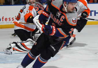 UNIONDALE, NY - NOVEMBER 23:  Mark Streit #2 of the New York Islanders skates against the Philadelphia Flyers at the Nassau Veterans Memorial Coliseum on November 23, 2011 in Uniondale, New York.  (Photo by Bruce Bennett/Getty Images)