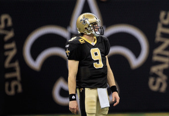 NEW ORLEANS, LA - JANUARY 01:  Drew Brees #9 of the New Orleans Saints stands on the field during the game against the Carolina Panthers at the Mercedes-Benz Superdome on January 1, 2012 in New Orleans, Louisiana.  (Photo by Chris Graythen/Getty Images)