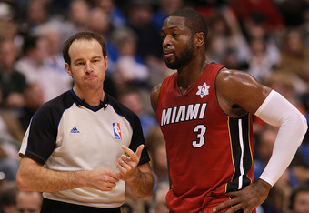 DALLAS, TX - DECEMBER 25:  NBA referee Josh Tiven #58 talks with Dwyane Wade #3 of the Miami Heat at American Airlines Center on December 25, 2011 in Dallas, Texas.  (Photo by Ronald Martinez/Getty Images)
