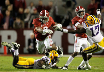 TUSCALOOSA, AL - NOVEMBER 05:  Trent Richardson #3 of the Alabama Crimson Tide carries the ball over Ryan Baker #22 of the LSU Tigers during the second half of the game at Bryant-Denny Stadium on November 5, 2011 in Tuscaloosa, Alabama.  (Photo by Streete