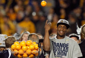 MIAMI GARDENS, FL - JANUARY 04:  Geno Smith #12 of the West Virginia Mountaineers celebrates after they won 70-33 against the Clemson Tigers during the Discover Orange Bowl at Sun Life Stadium on January 4, 2012 in Miami Gardens, Florida.  (Photo by J. Me