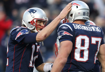 FOXBORO, MA - JANUARY 1:    Tom Brady #12 of the New England Patriots celebrates with teammate  Rob Gronkowski #87 of the New England Patriots after a touchdown against the Buffalo Bills in the second half at Gillette Stadium on January 1, 2012 in Foxboro