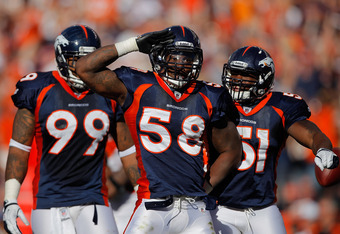 DENVER, CO - SEPTEMBER 18:  Linebacker Von Miller #58 of the Denver Broncos salutes to the fans and celebrates with teammates defensive tackle Kevin Vickerson #99 and linebacker Joe Mays #51 after making a sack on Cincinnati Bengals quarterback Andy Dalto
