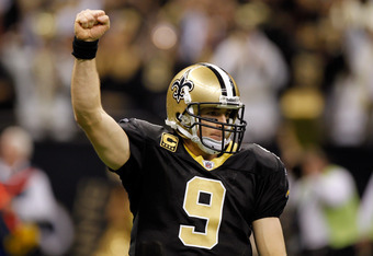 NEW ORLEANS, LA - DECEMBER 26:  Quarterback Drew Brees #9 of the New Orleans Saints reacts after throwing a nine-yard touchdown pass to running back Darren Sproles #43 and breaks the single-season passing record in the fourth quarter against the Atlanta F
