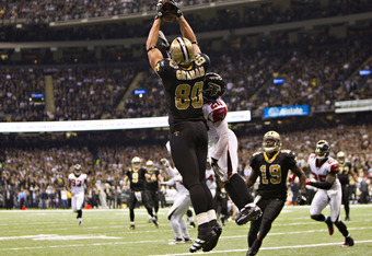 NEW ORLEANS, LA - DECEMBER 26:   Jimmy Graham #80 of the New Orleans Saints catches a touchdown pass against the Atlanta Falcons at Mercedes-Benz Superdome on December 26, 2011 in New Orleans, Louisiana.  The Saints defeated the Falcons 45-16.  (Photo by