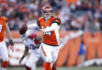 CINCINNATI, OH - DECEMBER 24: Andy Dalton #14 of the Cincinnati Bengals looks to pass against the Arizona Cardinals at Paul Brown Stadium on December 24, 2011 in Cincinnati, Ohio. The Bengals defeated the Cardinals 23-16. (Photo by Joe Robbins/Getty Image