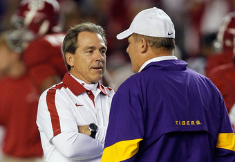 TUSCALOOSA, AL - NOVEMBER 05:  (L-R) Head coach Nick Saban of the Alabama Crimson Tide shakes hands with head coach Les Miles of the LSU Tigers before their game at Bryant-Denny Stadium on November 5, 2011 in Tuscaloosa, Alabama.  (Photo by Streeter Lecka