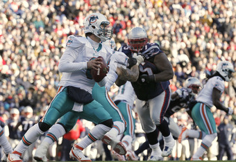 FOXBORO, MA - DECEMBER 24:  Matt Moore #8 of the Miami Dolphins drops back to pass during the second half of New England's 27-24 win at Gillette Stadium on December 24, 2011 in Foxboro, Massachusetts.  (Photo by Winslow Townson/Getty Images)
