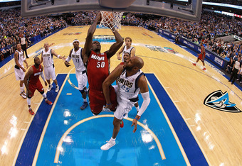 DALLAS, TX - DECEMBER 25:  Joel Anthony #50 of the Miami Heat and Vince Carter #25 of the Dallas Mavericks at American Airlines Center on December 25, 2011 in Dallas, Texas.  (Photo by Ronald Martinez/Getty Images)