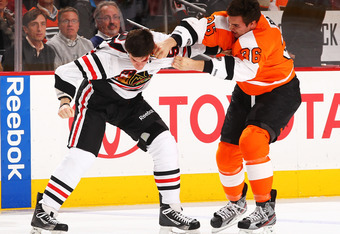 PHILADELPHIA, PA - JANUARY 05:  Andrew Shaw #65 of the Chicago Blackhawks fights Zac Rinaldo #36 of the Philadelphia Flyers during their game on January 5, 2012 at The Wells Fargo Center in Philadelphia, Pennsylvania.  (Photo by Al Bello/Getty Images)