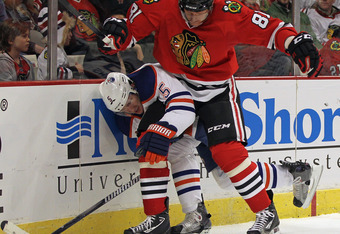 CHICAGO, IL - JANUARY 02:  Marian Hossa #81 of the Chicago Blackhawks battles with Ladislav Smid #5 of the Edmonton Oilers at the United Center on January 2, 2012 in Chicago, Illinois. The Oilers defeated the Blackhawks 4-3. (Photo by Jonathan Daniel/Gett