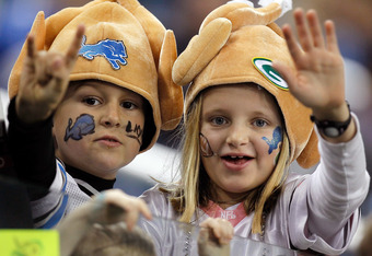 DETROIT, MI - NOVEMBER 24:  Two kids, a Detroit Lions fan and a Green Bay Packers fan, cheer on their teams before the Lions take on the Packers during the Thanksgiving Day game at Ford Field on November 24, 2011 in Detroit, Michigan.  (Photo by Gregory S