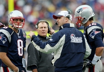 FOXBORO, MA - SEPTEMBER 27:  Quarterback coach Bill O'Brien (C) talks to (L-R) Brian Hoyer #8, head coach Bill Belichick and Tom Brady #12 of the New England Patriots in the third quarter of the game against the Atlanta Falcons at Gillette Stadium on Sept