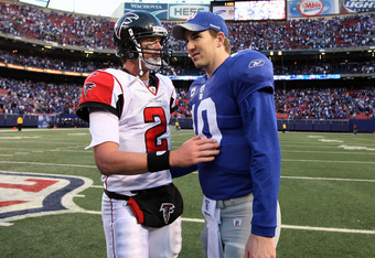 EAST RUTHERFORD, NJ - NOVEMBER 22:  Eli Manning #10 of the New York Giants talks with Matt Ryan #2 of the Atlanta Falcons after their game on November 22, 2009 at Giants Stadium in East Rutherford, New Jersey. The Giants defeated the Falcons 34-31 in over