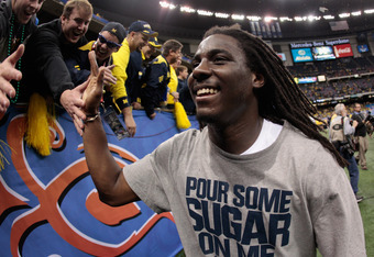 NEW ORLEANS, LA - JANUARY 03:  Denard Robinson #16 of the Michigan Wolverines celebrates as he runs off of the field after Michigan won 23-20 in overtime against Virginia Tech Hokies during the Allstate Sugar Bowl at Mercedes-Benz Superdome on January 3,