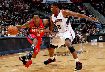 ATLANTA, GA - DECEMBER 30:  Marshon Brooks #9 of the New Jersey Nets drives against Joe Johnson #2 of the Atlanta Hawks at Philips Arena on December 30, 2011 in Atlanta, Georgia.  NOTE TO USER: User expressly acknowledges and agrees that, by downloading a