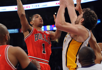 Derrick Rose #1 of the Chicago Bulls puts a shot up against Pao Gasol #16 of the Los Angeles Lakers during the game at Staples Center on December 25, 2011 in Los Angeles, California.  NOTE TO USER: User expressly acknowledges and agrees that, by downloadi