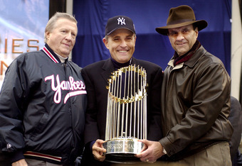 381058 14: New York Yankees owner George Steinbrenner, left, New York Mayor Rudy Giuliani, and Yankees manager Joe Torre, right, hold the World Series trophy October 30, 2000 after the Yankees'' victory parade in New York City. The Yankees defeated the Ne