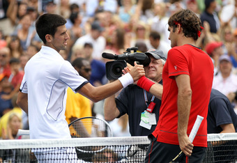NEW YORK, NY - SEPTEMBER 10:  Roger Federer (R) of Switzerland congratulates Novak Djokovic of Serbia after Djokovic won their match during Day Thirteen of the 2011 US Open at the USTA Billie Jean King National Tennis Center on September 10, 2011 in the F