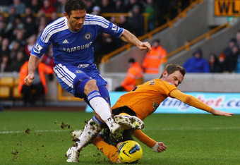 WOLVERHAMPTON, ENGLAND - JANUARY 02:  Richard Stearman of Wolverhampton Wanderers tackles Frank Lampard of Chelsea during the Barclays Premier League match between Wolverhampton Wanderers and Chelsea at Molineux on January 2, 2012 in Wolverhampton, Englan