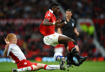 MANCHESTER, ENGLAND - MAY 23:   Paul Pogba of Manchester United is tackled by Terry Kennedy of Sheffield United during the FA Youth Cup Final 2nd Leg match between Manchester United and Sheffield United at Old Trafford on May 23, 2011 in Manchester, Engla