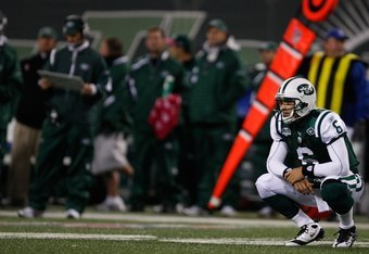 EAST RUTHERFORD, NJ - OCTOBER 18: Mark Sanchez #6 of the New York Jets crouches to the ground after throwing an interception against the Buffalo Bills during the game on October 18, 2009 at Giants Stadium in East Rutherford, New Jersey. The Bills defeated