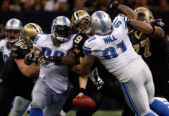 NEW ORLEANS, LA - DECEMBER 04:  Quarterback Drew Brees #9 of the New Orleans Saints is sacked by defensive tackle Sammie Lee Hill #91 of the Detroit Lions at Mercedes-Benz Superdome on December 4, 2011 in New Orleans, Louisiana.  (Photo by Chris Graythen/