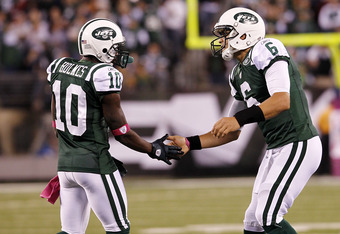 EAST RUTHERFORD, NJ - OCTOBER 17:  Mark Sanchez #6 and  Santonio Holmes #10 of the New York Jets celebrate  during a game against the Miami Dolphins at MetLife Stadium on October 17, 2011 in East Rutherford, New Jersey.  (Photo by Jeff Zelevansky/Getty Im
