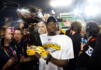 TAMPA, FL - FEBRUARY 01:  Super Bowl MVP Santonio Holmes #10 of the Pittsburgh Steelers celebrates with the Vince Lombardi trophy after the Steelers won 27-23 against the Arizona Cardinals during Super Bowl XLIII on February 1, 2009 at Raymond James Stadi