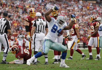 LANDOVER, MD - NOVEMBER 20:  DeMarcus Ware #94 of the Dallas Cowboys celebrates after sacking  Rex Grossman #8 of the Washington Redskins during the second half at FedExField on November 20, 2011 in Landover, Maryland.  (Photo by Rob Carr/Getty Images)