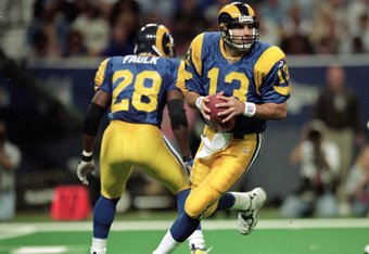 28 Nov 1999: Kurt Warner #13 of the St. Louis Rams runs to pass the ball during a game against the New Orleans Saints at the Trans World Dome in St. Louis, Missouri. The Rams defeated the Saints 43-12. Mandatory Credit: Elsa Hasch  /Allsport