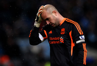 MANCHESTER, ENGLAND - JANUARY 03:  Pepe Reina of Liverpool looks dejected during the Barclays Premier League match between Manchester City and Liverpool at the Etihad Stadium on January 3, 2012 in Manchester, England.  (Photo by Clive Brunskill/Getty Imag