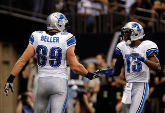 NEW ORLEANS, LA - JANUARY 07:  Will Heller #89 of the Detroit Lions celebrates with teammate  Nate Burleson #13 after scoring a touchdown in the first quarter against the New Orleans Saints during their 2012 NFC Wild Card Playoff game at Mercedes-Benz Sup