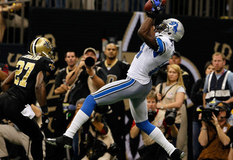 NEW ORLEANS, LA - JANUARY 07:  Calvin Johnson #81 of the Detroit Lions catches a pass for a touchdown in the second quarter against Malcolm Jenkins #27 of the New Orleans Saints during their 2012 NFC Wild Card Playoff game at Mercedes-Benz Superdome on Ja