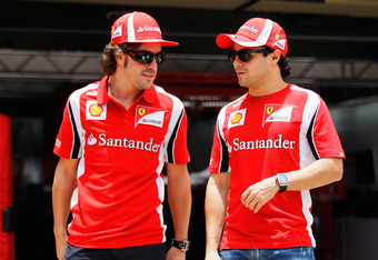 SAO PAULO, BRAZIL - NOVEMBER 24:  Fernando Alonso of Spain and Ferrari and Felipe Massa of Brazil and Ferrari are seen during previews to the Brazilian Formula One Grand Prix at the Autodromo Jose Carlos Pace on November 24, 2011 in Sao Paulo, Brazil.  (P