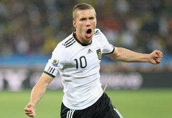 Podolski celebrates a goal for Germany.