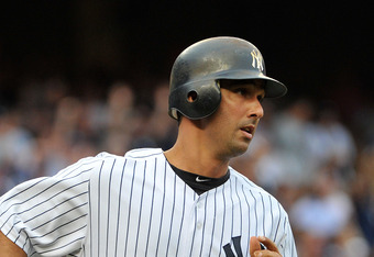NEW YORK, NY - AUGUST 13: Jorge Posada #20 of the New York Yankees watches his grand slam as he runs up the first base line in the bottom of the fifth inning against the Tampa Bay Rays at Yankee Stadium on August 13, 2011 in the Bronx borough of New York