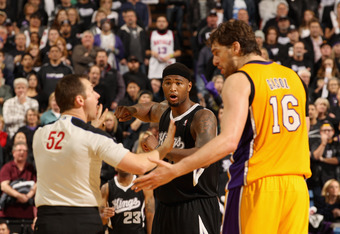 SACRAMENTO, CA - DECEMBER 26:  Referee Scott Twardoski separates DeMarcus Cousins #15 of the Sacramento Kings and Pau Gasol #16 of the Los Angeles Lakers during their game at Power Balance Pavilion on December 26, 2011 in Sacramento, California. Both play